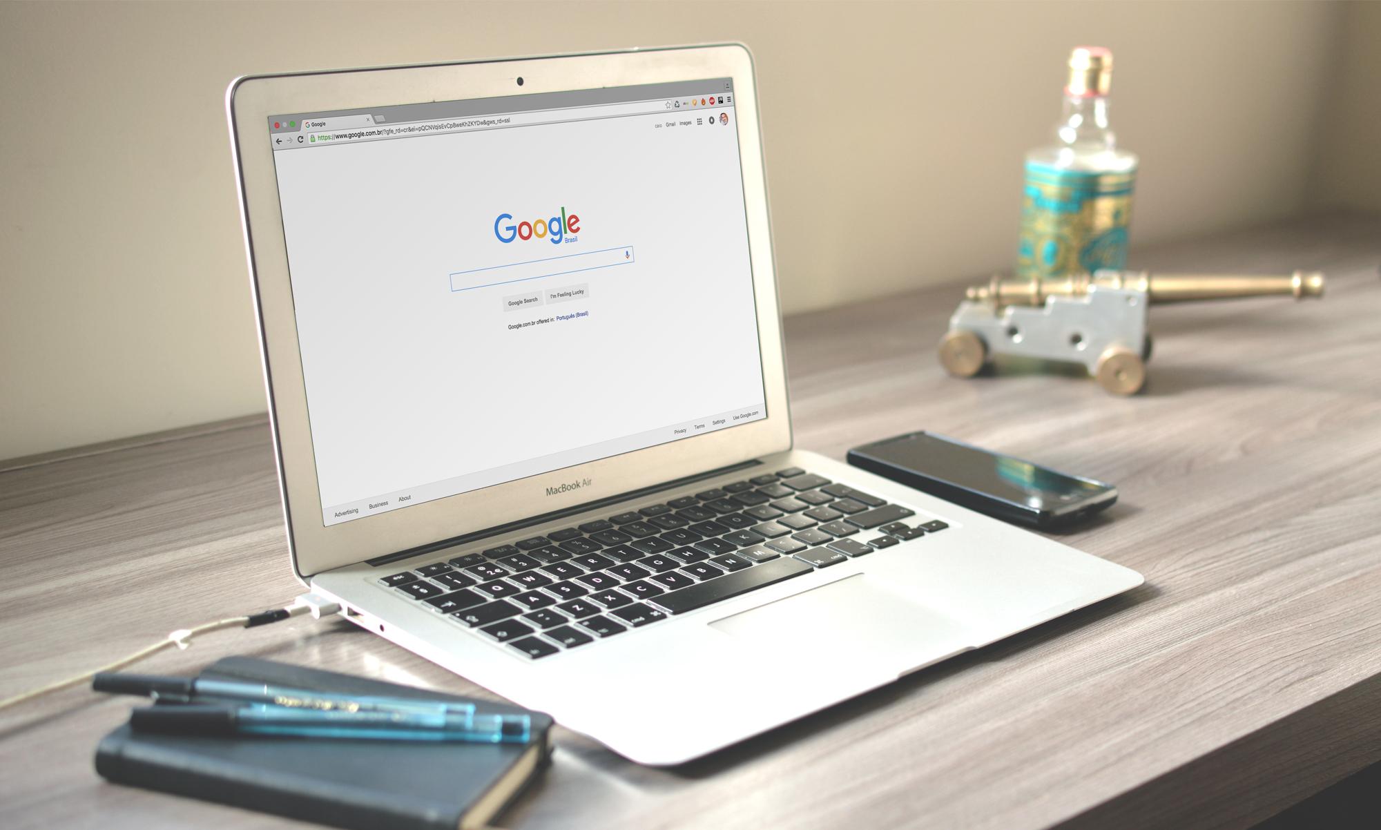 Laptop displayed Google Homepage